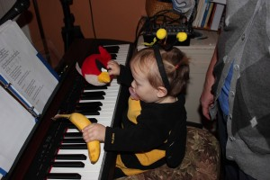 playing the piano with a banana and an angry bird