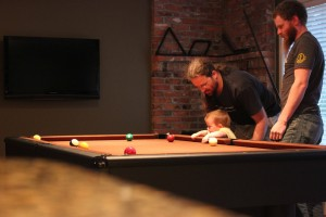 helping Daddy with his pool game